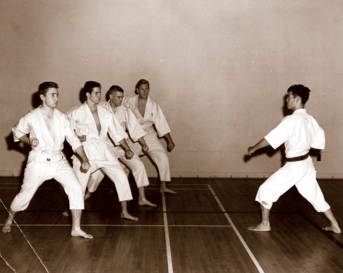 Ohshima Sensei leading down block practice in the Caltech gym during early years.