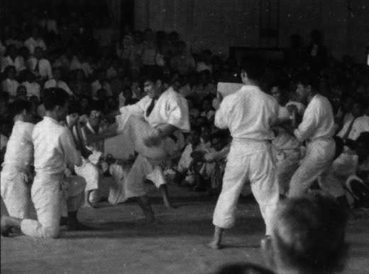 Mr. Ohshima breaking boards using four different methods during the first karate demonstration witnessed by the general public at Nisei Week in Little Tokyo, 1957